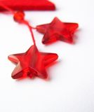 Stars. Christmas decorations. Two red stars on a white background - christmas decorations Stock Photos