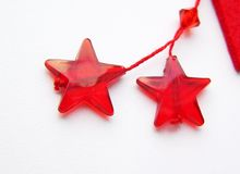 Stars. Christmas decorations. Two red stars on a white background - christmas decorations Royalty Free Stock Photos
