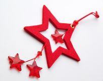 Stars. Christmas decorations. FOUR red stars on a gray background - christmas decorations Royalty Free Stock Images