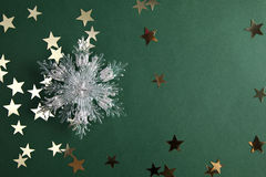 Stars and christmas snowflake on green. Golden stars, space for a text Royalty Free Stock Photos
