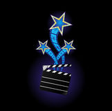 Stars from cinema. Three neon stars comming out from clapboard Royalty Free Stock Photo