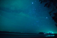 The stars in the cloudy night sky at the sea in Thailand. The cloudy night sky with a stars, Thailand royalty free stock photo