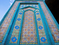 Stars and colorful patterns of Persian tiles on the wall of the 19 century mosque in the old city of Iran Royalty Free Stock Photo