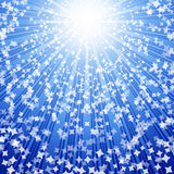 Stars coming down on rays of light. Stock Photography