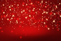 Christmas star background. Stars confetti flying ower red background Stock Photography