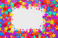 Stars confetti on a purple background, frame Stock Images
