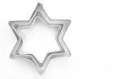 Stars cookie cutter. On white background Stock Photography