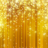 Stars descending on golden background Stock Image