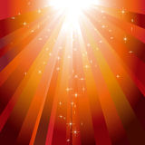 Stars descending on orange light burst. Glitter stars descending on sparkling orange light burst background Stock Images