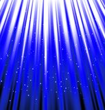 Stars are falling on the background of blue rays. Royalty Free Stock Image