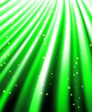 Stars are falling on the background of green rays. Stock Images