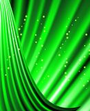 Stars are falling on the background of green rays. Stock Image