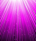 Stars are falling on the background of purple rays. Royalty Free Stock Photo