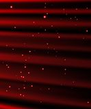 Stars are falling on the background of red rays. Royalty Free Stock Photo
