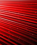 Stars are falling on the background of red rays. Royalty Free Stock Image