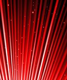 Stars are falling on the background of red rays. Royalty Free Stock Images