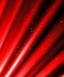 Stars are falling on the background of red rays. Snow and stars are falling on the background of red luminous rays Stock Photo