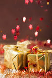Stars falling over christmas gifts Royalty Free Stock Image