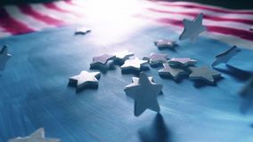 Stars falling on painted American flag, the symbol of the USA. Super slow motion shot. White stars falling on painted American flag, the symbol of the USA. Super stock footage