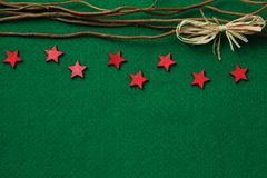 Stars on felt background. Red stars on green felt background royalty free stock photos