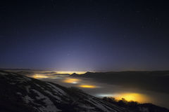 Stars in a foggy night over the valley Stock Photos