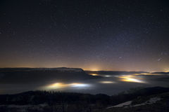 Stars in a foggy night over the valley royalty free stock image