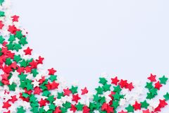 Stars frame. Frame made of small colored stars on the white background Stock Photo
