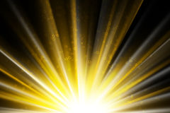 Stars on a golden rays of light Royalty Free Stock Photography