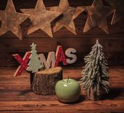 Stars, green apple, fir tree and christmas wooden letters Royalty Free Stock Photography