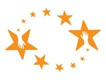Stars hands. Hands in the orange coloured rounding stars Stock Image