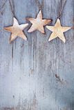 Stars hanging on wooden board Royalty Free Stock Image