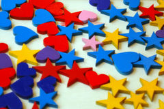 Stars and hearts. A lot of small color hearts and stars as a background royalty free stock photos