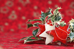 Stars and holly on Christmas background Royalty Free Stock Photos