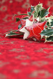 Stars and holly on Christmas background Royalty Free Stock Images