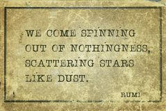 Stars like dust Rumi. We come spinning out of nothingness, scattering stars like dust - ancient Persian poet and philosopher Rumi quote printed on grunge vintage royalty free stock photo