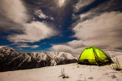 Stars and moon in mountain night sky. Tent in the mountains , camping night Royalty Free Stock Photos