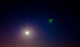 Stars and moon over night sky Royalty Free Stock Image