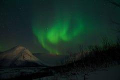 Stars, mountains and Aurora polaris. Aurora polaris star night above a mountain valley royalty free stock photo