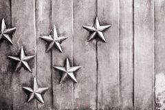 Stars Mounted On A Vertically Lined Background Stock Photos