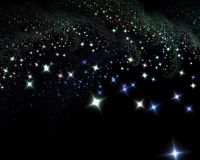 Stars at night. A shower of twinkle stars against a night sky Stock Images