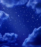 Stars In Night Sky. A night sky with stars and clouds Stock Images