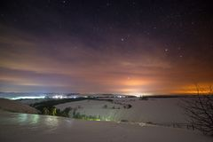 Stars of the night sky are hidden by clouds. Snowy winter stock images