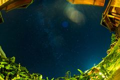 Stars in night sky over home and tree Milky Way Royalty Free Stock Images