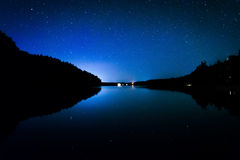 Stars in the night sky reflecting in Echo Lake, at Acadia Nation Stock Photography