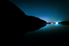 Stars in the night sky reflecting in Echo Lake, at Acadia Nation Royalty Free Stock Image