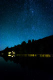 Stars in the night sky reflecting in Echo Lake, at Acadia Nation Stock Photo
