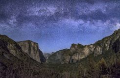 Are the Stars Out Tonight. Yosemite Valley, from Tunnel View, is softly illuminated by the setting moon with the Milky Way above stock photography