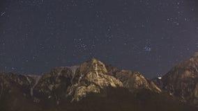 Stars over Bucegi mountain peak stock footage