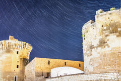 Stars over castle. Stars over a castle in Venosa, a small town in south Italy royalty free stock photo