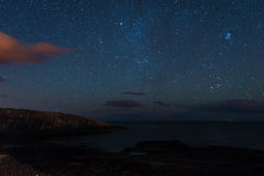 Stars over Cullernose Point Royalty Free Stock Photos